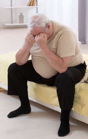 men s: Overweight senior man Concerned With His health