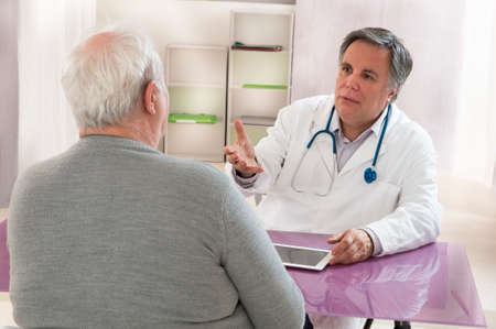 doctor consultation: Overweight Senior man visiting doctor
