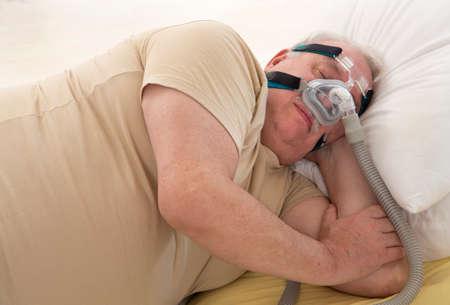 exhalation: Senior Man with sleeping apnea and CPAP machine