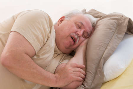 Close up of senior man sleeping and Snoring in bed Stock Photo