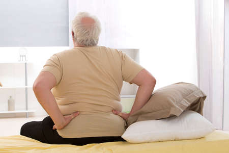 back  view: Man suffering from backache Stock Photo