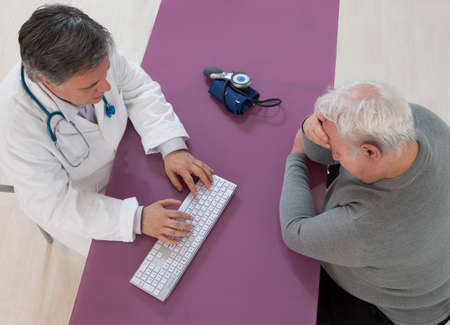 doctor burnout: Depressed senior man visiting doctor