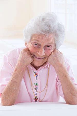 Portrait of a smiling old woman closeup photo