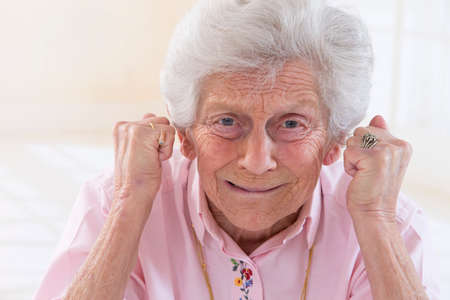 angry person: Angry old woman making fists