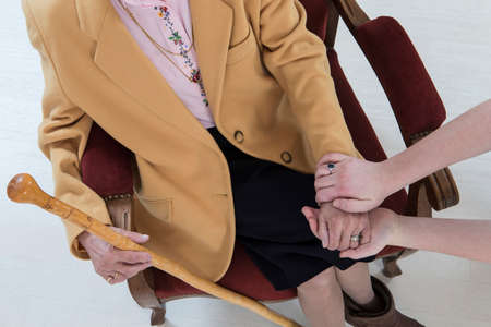 Hands of young and senior women photo