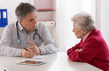 doctor explaining diagnosis to His female patient photo