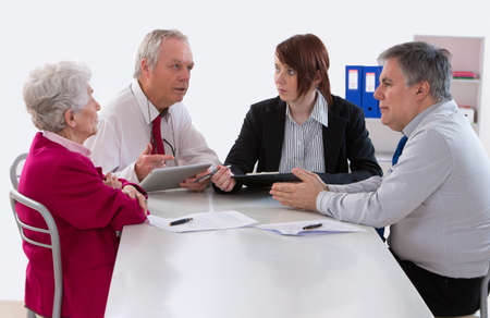 and heritage: inheritance counselor meeting with Senior woman about her Last Will Stock Photo
