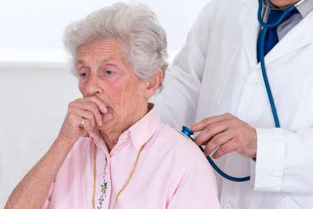 auscultation: Doctor auscultating senior patient