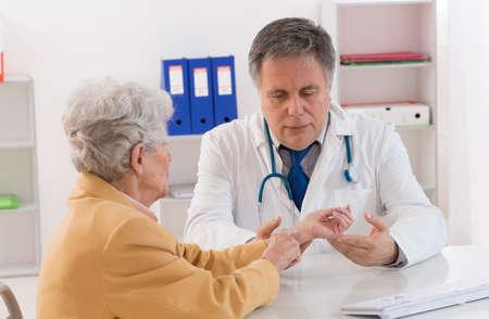prescribe: senior woman, wrist bread Stock Photo