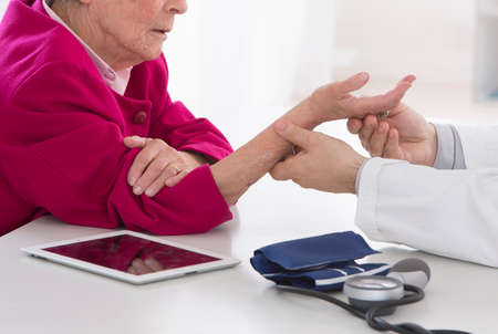 auscultation: senior woman wrist auscultation
