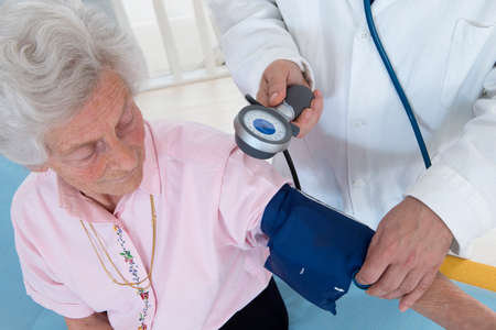 cuff: Doctor Taking the blood pressure of a patient Stock Photo