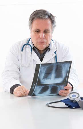 torax: Mature doctor examining an x-ray Stock Photo
