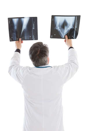 mature doctor: Mature doctor examining an x-ray Stock Photo