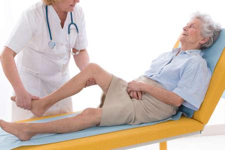 sprained joint: Rheumatology Consultation Senior Stock Photo