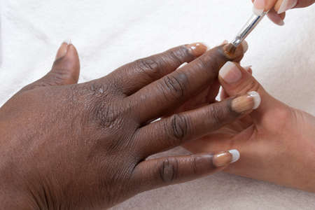 french ethnicity: Manicure process in beauty salon close up
