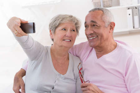 Couple taking selfie on smartphone photo