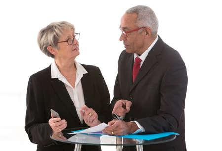 industrie: Businessman And Businesswomen Having Informal Meeting In Office Stock Photo