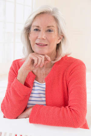 Attractive Senior woman portrait, on bright background with white hair