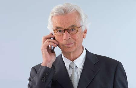 explanations: Senior  executive man giving explanations talking at phone mobile