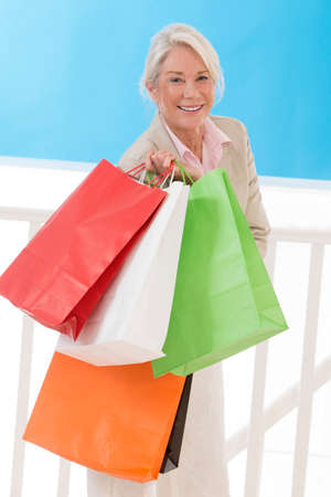 woman s bag: Beautiful senior woman with a lot of shopping bags