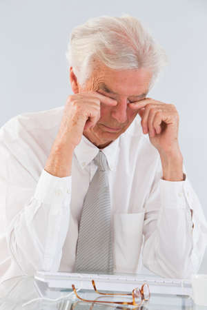 rubbing: Senior Businessman Rubbing His Eyes