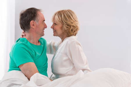courting: Portrait Of Happy Senior Couple Together In Bed