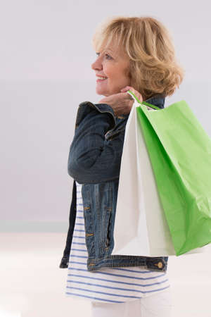 bargains: Senior on a shopping trip, eHappy  about her bargains