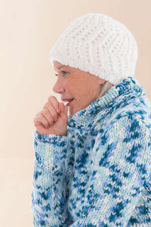old women: Senior woman in winter clothe, coughing Stock Photo
