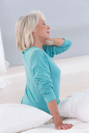hair problem: profile view of a sebior woman having neck pain