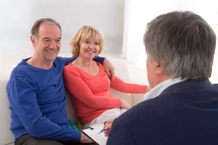 advising: Senior couple discussing financial plan with consultant