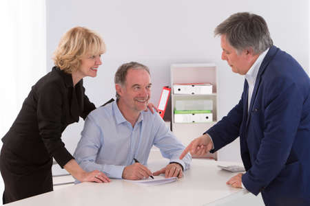 financial planning married: Senior couple writing signature under contract after financial consultation