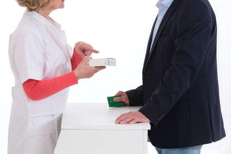 medicalcare: Senior man talking with woman pharmacist Stock Photo