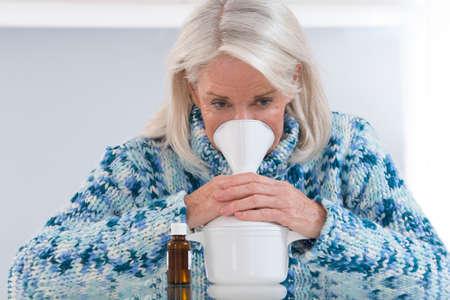 inhalation: Senior woman making inhalation