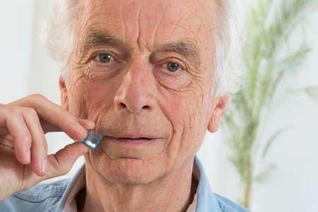 globule: Senior man tacking  homeopathic medicine