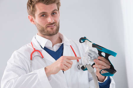 Doctor explaining the CPAP machine and mask Concept  for sleep apnea Stock Photo