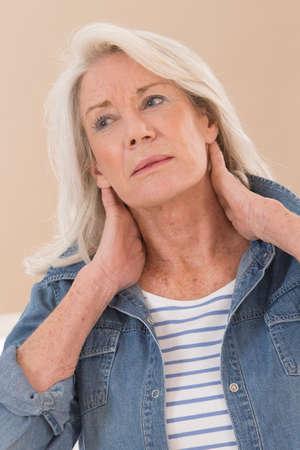 senior man on a neck pain: Senior woman has neck pain Stock Photo