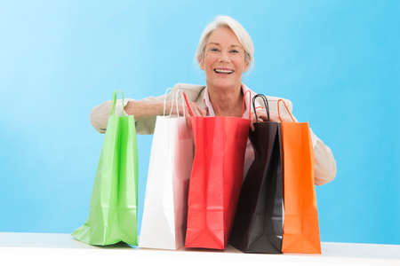 shopper: Beautiful middle aged woman checking her shopping bags