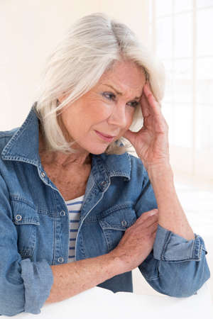 senior female: senior lady having headache Stock Photo