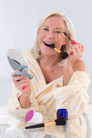 make over: Senior woman applying mascara