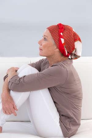 seniors suffering painful illness: portrait of a thoughtful senior woman