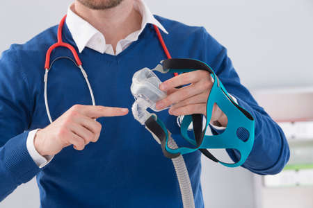 sleep: Doctor explaining the CPAP machine and mask Concept  for sleep apnea Stock Photo