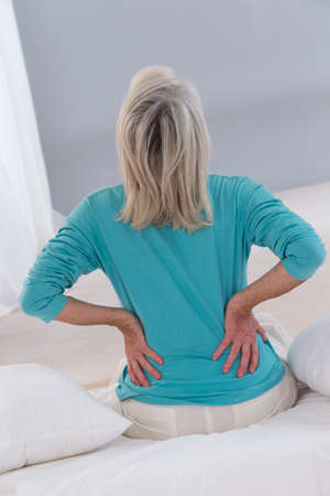 woman back: senior man suffing from her back Stock Photo