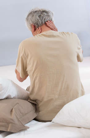 senior man on a neck pain: Neck pain , back view
