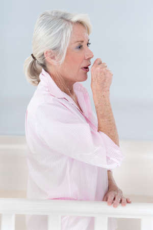 age old: Sick woman coughing with sore throat