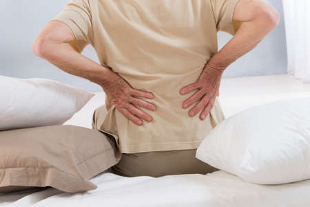 BACK bone: back ache senior man