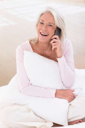 phonecall: Happy senior woman talking on mobile phone Stock Photo