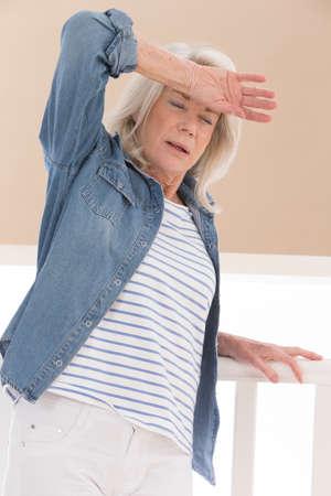 bad feeling: senior woman feeling bad