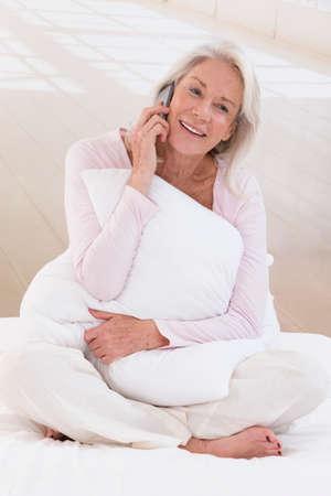 phonecall: Happy senior woman talking on mobile phone Stock Photo