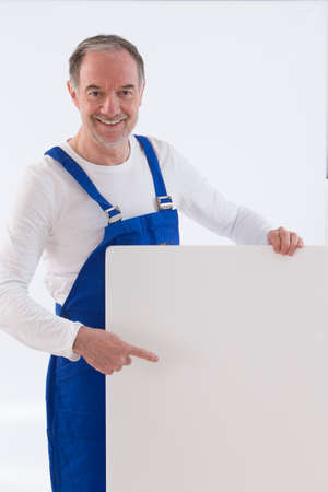 placard: happy craftsman indicating down at whiteboard isolated over white
