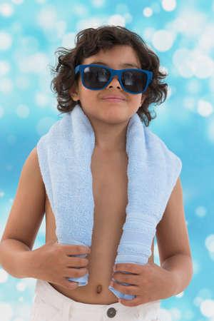 child portrait: little boy blue backgroung, ready for sunbathes